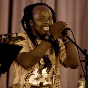 """""""Now comes the part where we throw our heads back and laugh..."""" Enter roots-Afrobeat giggle merchants RAS BANAMUNGU and THE DET-N-ATORS"""